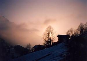 Early winter sunset behind the farmhouses of Rougemont