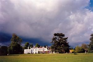 sun on school, south lawn, heavy cloudy sky, intense colours, great picture needs cropping