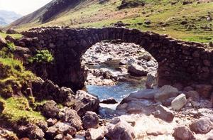 Stone bridge over very stony stream