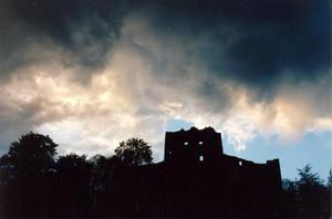 heavy hanging clouds over ruins