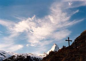 Matterhorn, cross and clouds