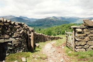 Stone walls with fence, with view over hillls
