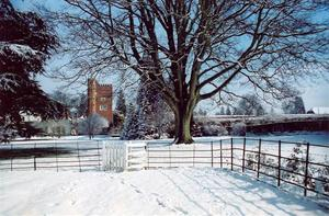 View of Tower from southern field with gate, snow