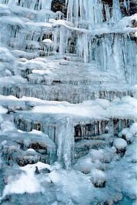 Blue ice formations on waterfall