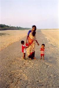 Mother with two kids on the beach