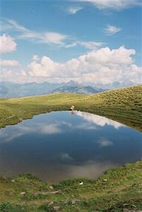 Mountain lake mirroring clouds
